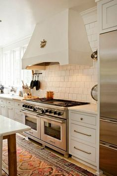 custom plaster range hood by Cantley and Company via Atticmag