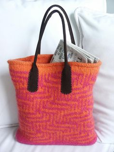 orange and hot pink + felted... :)    I love everything about this bag - the colors, the straps, the pattern!  Awesome.