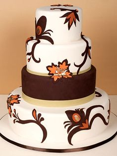 Four round tiers covered in white chocolate and chocolate fondant with handpainted fondant overlays. Cake by Take the Cake.