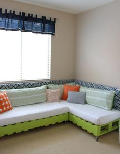 DIY pallet bed that also serves as seating in room.