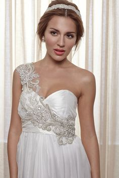 Unique embellishments on this one shouldered wedding dress by Anna Campbell