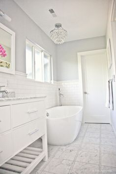 In terms of paint, we went with benjamin moore's aura paint in Sidewalk gray. The Aura line of paints has a great flat finish but is good for bathrooms.