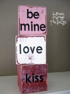 Valentines- Conversation Blocks: 4x4 post (cut into perfect squares) + Spray Paint (red, pink, cream) + Sander + Vinyl Lettering