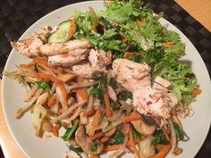 Stir fryed veggies, salad and chicken breast.