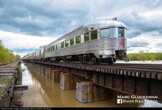 """www.railpictures.net photo 625870 The former New York Central Babbling Brook is bringing up the markers on Amtrak's Train 48 on May 8, 2017 as it enters the Howland Island State Wildlife Management Area passing milepost 320 in Savannah, NY. This car served this route on the Chicago to Boston """"New England States"""" from 1949-1957 before later being sold to Canadian Pacific Railroad."""