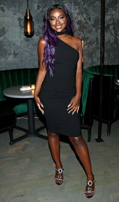 Justine Skye in a black one-shoulder choker dress