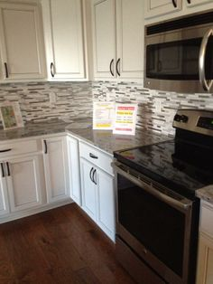 Backsplash with white cabinets, but with satin nickel pulls