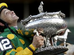 Jockey Mike Smith holds the Belmont Stakes trophy in the winner's circle after riding Palace Malice to win the race at Belmont Park in Elmont, NY, on Saturday (© Seth Wenig/AP) The Belmont Stakes, Triple Crown Winners, Mike Smith, American Pharoah, Run For The Roses, Famous Sports, Churchill Downs, Sport Of Kings, Thoroughbred