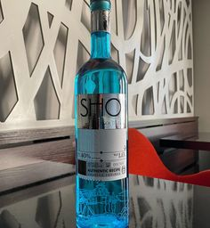 """The name of the project SHO (""""WHAT"""" in the Eastern Ukrainian common parlance) sounds as a song for every inhabitant of Kharkiv region! And the look of the sky blue bottle with the exquisite printing at the bottom (painting + screen-printing with UV-inks) is very pleasing for the eye! Blue Bottle, Vodka Bottle, Screen Printing, Sky, Songs, Drinks, Painting, Screen Printing Press, Heaven"""