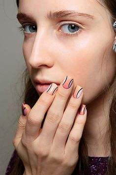 Nail Ideas for Winter and Holiday 2015: Curved black lines over warm nude tones makes for a fresh take on stripes.