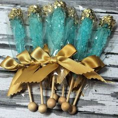 Give your guests a sweet treat for the road by laying out these beautifully dipped rock candy sugar sticks in custom colors. #DIY #WeddingFavors