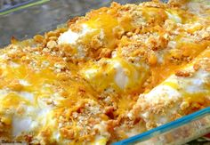 CAESAR ORANGE ROUGHY 2 pounds fresh or frozen orange roughy fillets, thawed 1 cup Caesar salad dressing (My favorite brand is Cardini's) 2 cups crushed butter-flavored crackers (about 50 crackers, I used Ritz) 1 cup (4 ounces) extra-sharp cheddar cheese