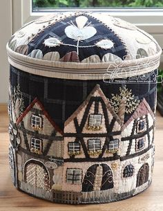 This adorable round XL box - pattern: Townhouses in Alsace(c) was inspired by cultural and historical region in eastern France, located on the west bank of the upper Rhine, adjacent to Germany and Switzerland. All traditional houses with walls in timber framing and roofing in flat tiles - just stolen my heart! I decided to make a big round, zipper-closed box with Alsatian Townhouses appliquéd motifs.. Even the flap of this box is decorated with Alsatian floral motifs, came from historical…