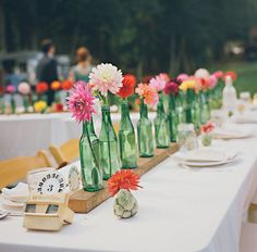 green bottle single flower centerpiece- love the design Wedding Bottles, Diy Wedding Flowers, Wedding Table Centerpieces, Flower Centerpieces, Flower Vases, Flower Decorations, Wedding Centerpieces, Flower Arrangements, Wine Bottle Centerpieces
