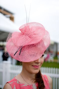 This classic pink look will fit in perfectly in the Grandstand at Royal Ascot. The peacock quills really top off the sophisticated style. Ascot Hat Inspirations
