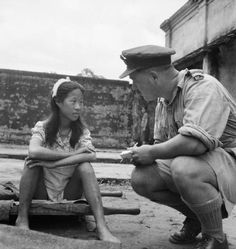 """A Chinese girl from one of the Japanese Army's 'comfort battalions' awaits interrogation at a camp in Rangoon - 8 August 1945. The term """"comfort women"""" was a euphemism used to describe women forced into sexual slavery by the Japanese military during World War II."""