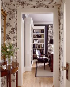 Charcoal and white floral wallpaper hallway by Hyde Evans Design