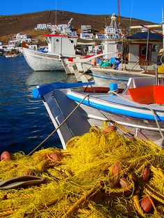 Colorful row of fishing boats with yellow fishing nets, Merihas, Kythnos island, Cyclades, Greece Cradle Of Civilization, Greece Islands, Fishing Boats, Beautiful Beaches, Sailing, Scenery, Tours, Places, Magic Circle