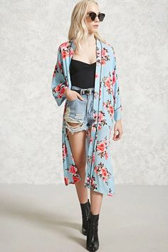 A woven kimono featuring an allover rose print, longline silhouette, contrast piping, side slits, an open-front, and long sleeves.