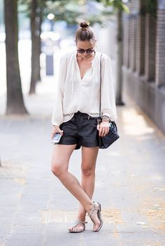 A billowy white blouse with neck tie details give off a light and airy boho vibe. Pair it with shorts and animal print sandals for an easy, go-to summer outfit.