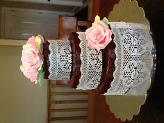 Chocolate cake with caramel Swiss meringue buttercream, chocolate ganache glaze, sugar veil edible lace, and hand sculpted sugar paste roses.