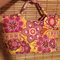 LOVELY VERA BRADLEY HANDBAG LOVELY VERA BRADLEY HANDBAG ️GORGEOUS COLOR PATTERN, PINKS, RUSTIC YELLOW, BURNT ORANGE, FUCIA. THERE ARE 2 LARGE OUTER POCKETS ON EITHER END OF PURSE. Inside there are 3 slip pockets, and 1 zipper pocket, all 4 pockets are good size. GREAT CONDITION!!! INSIDE and OUT!!! Any questions? PLEASE ASK Vera Bradley Bags