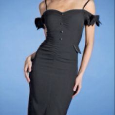 1940s sultry black wiggle dress exudes sensuous old glamour..