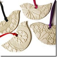 doily ornaments ... plaster of paris, maybe? can't tell, but these are lovely and i'd love to make some as gifts