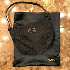 Fendi mini baguette Black fabric monogram mini baguette. Very gently used and well cared for. Some small scratches to the inner and outer silver plates from use, as pictured. Not very noticeable when used. Comes with dust bag. FENDI Bags Satchels