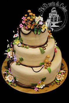Edible flowers, butterflies, and mushrooms adorn this woodsy cake for a couple who wanted a very organic, natural wedding. By Ph.D.-serts & Cakes.