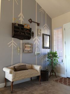 Great idea to spice up a wall with paint pattern and accessories - no wallpaper in sight!