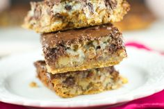 Hello Dolly Bars: these magic bars are made a graham cracker crust, chocolate…