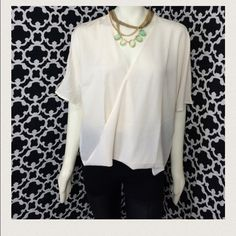 """LISTING Ivory Sheer Cross Front Top Cute pair with leggings Ivory Sheer Cross Front Top. Measures 24"""" long, PTP 29"""". Material 100% poly Alice Moon Tops"""