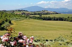 Italy Travel Guide: Umbria's rolling landscape seen from a hillside villa near Todi and Orvieto