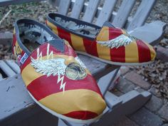 Harry potterGrifindor colorson  TOMS shoesmade to by ArtfulSoles, $130.00  I want those so bad but they're expensive :(((