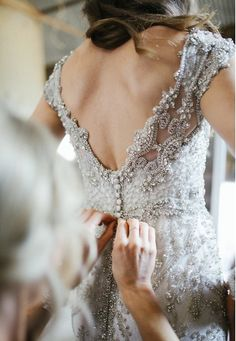 Elegant wedding dress inspiration | I'm in love with the pearl details of this back. Absolutely stunning