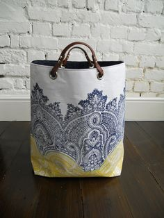 Large Hand block printed Linen Hamper with leather handles Ornate Baron. via Etsy. Hand Printed Fabric, Printed Linen, Tote Purse, Tote Handbags, Fabric Storage Bins, Linen Bag, Fabric Bags, Summer Bags, Shopper