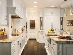 This is very much how I imagine the layout in My Dream Coastal Kitchen: floor-to-ceiling cabinetry, farmhouse sink in the island in front of the range. Additionally, I can see a U-shaped kitchen with 3 walls of cabinetry, rather than the overly-popular open floor plan.
