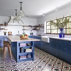Dream kitchen! Love the statement tiles and punchy blues of this beauty found via @onekingslane