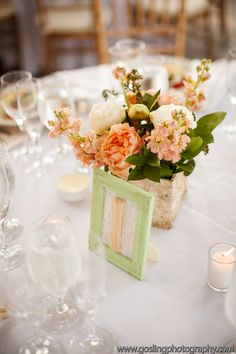 peach, white and green centerpiece idea   floral creations