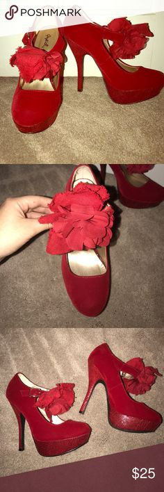 Red suede heels! These shoes are absolutely gorgeous! Only worn a few times, plenty of miles left in these red heels! About a four inch heel. Size 7 with adjustable clasp. Qupid Shoes Heels