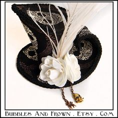 Etsy - BubblesAndFrown - Sugar Skull: asymmetrical mini top hat in Day of the Dead Fabric. $97