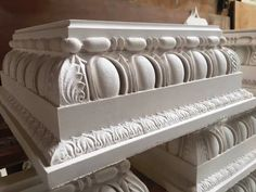 A closeup of highly detailed Roman Doric plaster full squares. Plaster Mouldings, Cabinet Trim, Concrete Casting, Ceiling Medallions, Stone Carving, Antique Furniture, Classic Style, New Homes, Acanthus