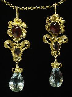 Garnet and aquamarine earrings, France, 19th century, garnet cabochons, pair-shape aquamarines, 18k gold, 4.5 × 1.6cm, 6.9g