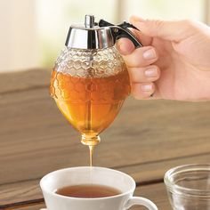 Honey & Syrup Dispenser The neat, easy way to avoid the sticky drips that come with standard pour-bottles.