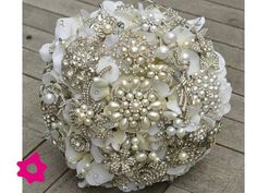I want a broche bouquet whenever that times comes but with coral background to it!!!