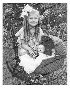 Little Girl with Doll in Wicker Buggy (ca 1900)