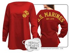 Featured here is our U.S. Marines Spirit Jersey!  This oversized jersey is perfect to show your support for the U.S. Marines and/or your Marine! This oversized fit pullover is constructed of 6.6 oz; 100% cotton jersey. Includes double athletic stripes on the sleeves.  Our spirit jerseys are garment-dyed for a vintage feel and a roomy fit.   These pullovers run large, so we recommend a size down.  Customize this item even more by adding a custom name on it. Please make sure you double check…