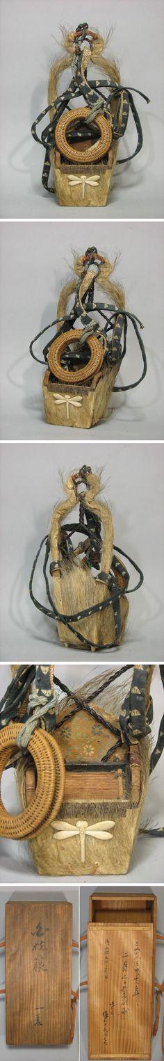 White boar hair quiver (sakatsura Ebira), Edo Period, with original straps and tsurumaki (woven string holder), 38cm high.