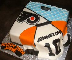 A different spin on a hockey cake. Love the puck coming at ya!